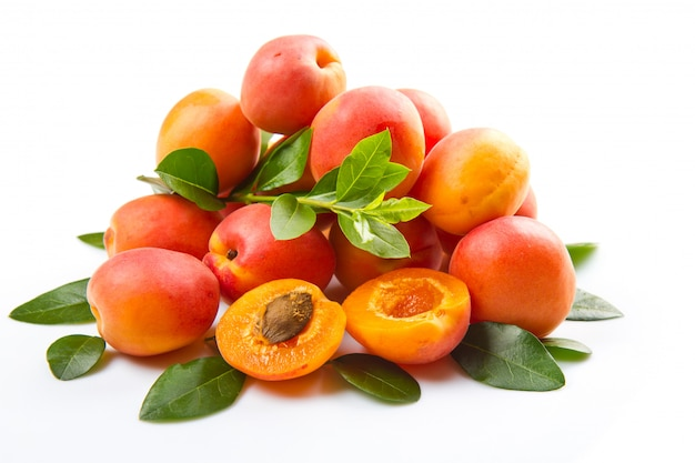 Fresh apricots with leaf on white