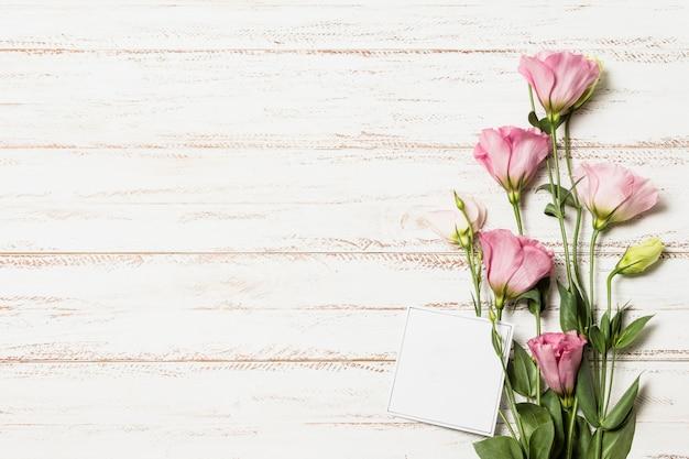 Fresh aromatic flowers near paper
