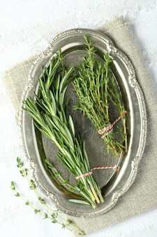 Fresh aromatic herbs rosemary and thyme on metal plate