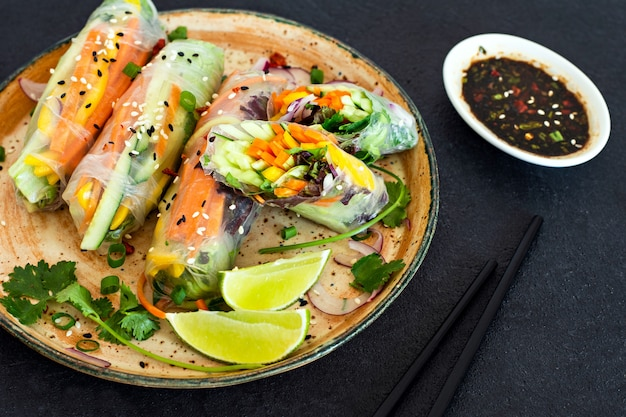 Fresh asian appetizer spring rolls (nem) made from rice paper and raw vegetables. vietnamese food