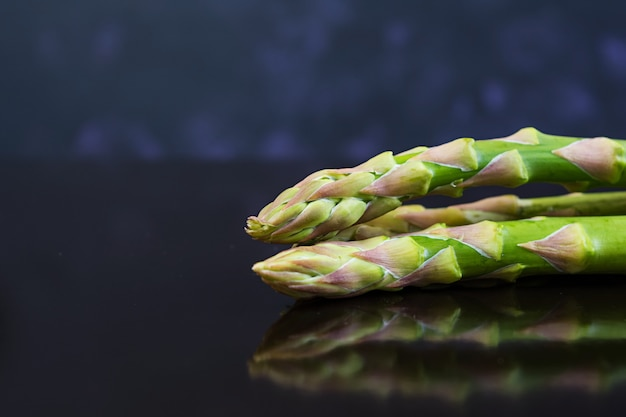 Fresh asparagus on dark