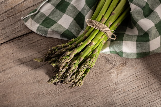 Fresh asparagus on wood