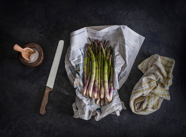 Fresh asparagus wrapped in newspaper