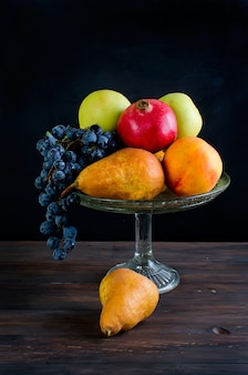 Fresh autumn fruits - pomegranate, pears, grapes and apples