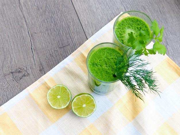 Fresh avocado smoothie on gray