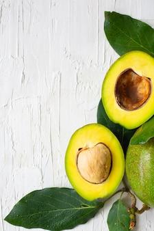 Fresh avocado on white
