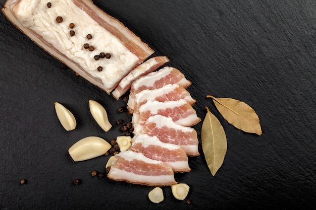 Fresh bacon with garlic and peppercorns, bay leaf. ukrainian traditional cuisine.