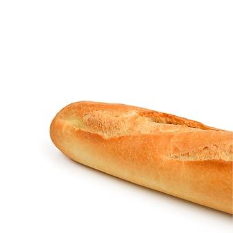 白い表面に長く、影で隔離された新鮮なバゲットパン。 Premium写真
