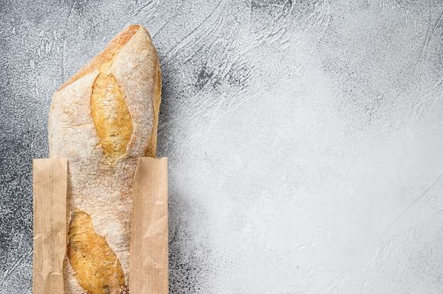 Fresh baguette in a paper craft bag