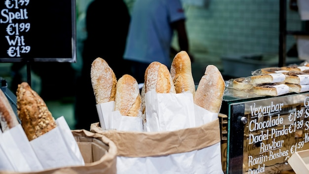 Fresh baked baguettes in the baker shop