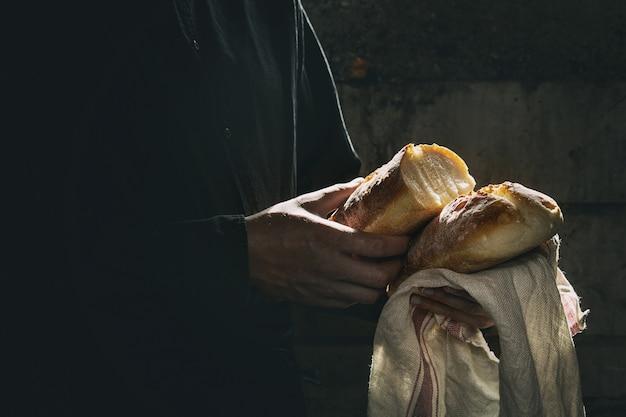 Fresh baked bread in hands