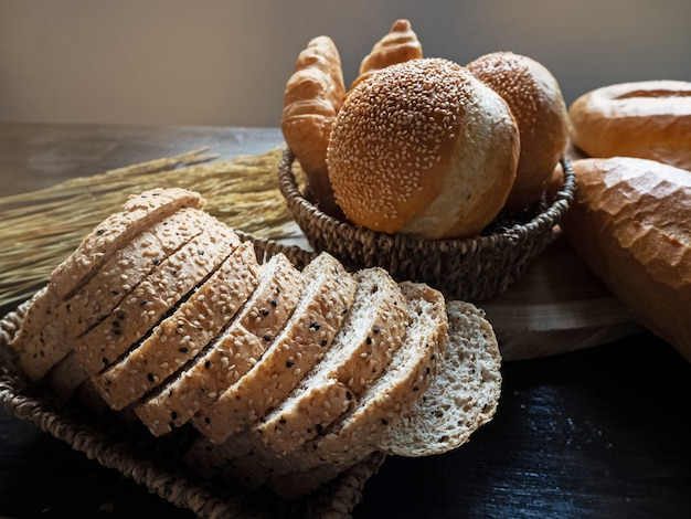 Fresh baked bread put on woven basket,