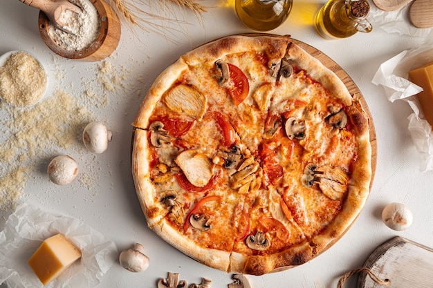 Fresh baked chicken and mushroom pizza on white