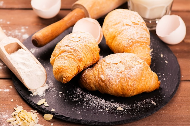 Fresh baked croissants with almond leaves