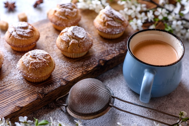 Fresh baked cupcakes of rice flour with banana and vanilla with a mug of hot chocolate. delicious invigorating breakfast with hot chocolate and cupcakes