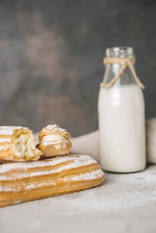 Fresh baked homemade eclair with milk bottle
