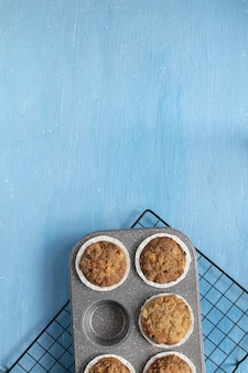 Fresh baked muffins on bright blue