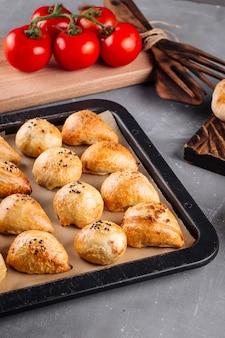 Fresh baked oriental pies samsa on a tray
