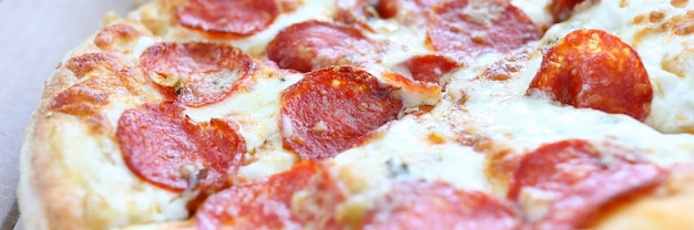 Fresh baked pizza with crusty cheese and hot tasty pepperoni ready to eat