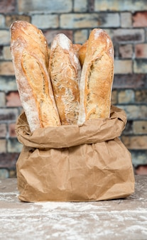 Fresh baked rustic bread loaves in paper bags