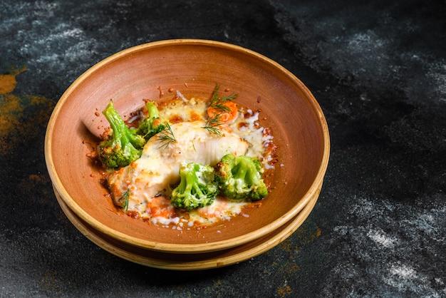 Fresh baked sea fish with broccoli