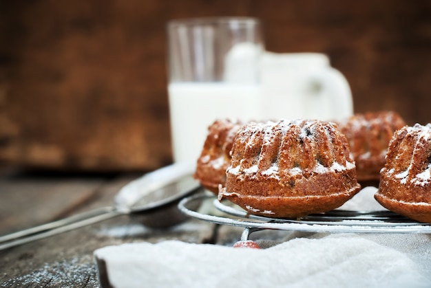 Fresh baked sweet cake with icing sugar and milk