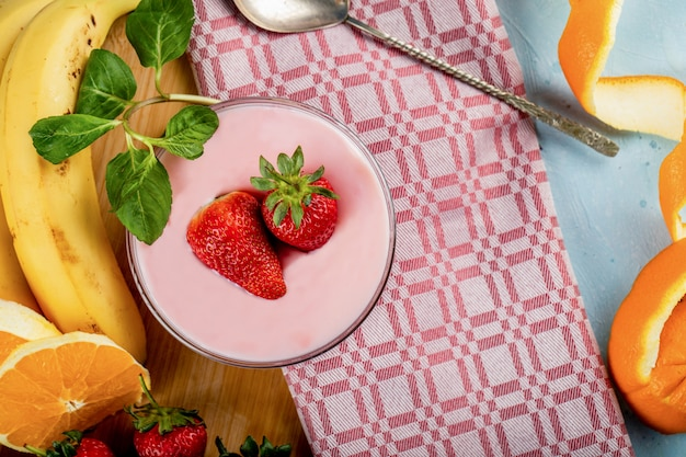Fresh banana,orange and strawberries with a bowl of pudding