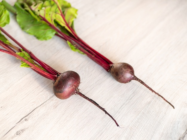 Fresh beautiful washed beets on a light table.