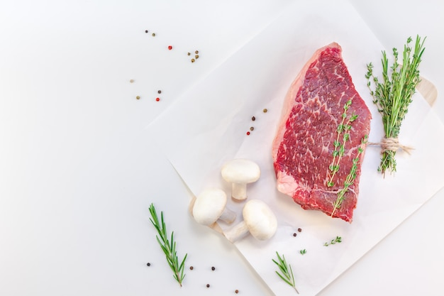 Fresh beef fillet with ingredients in cooking