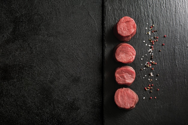 Fresh beef medallions on a kitchen cutting board