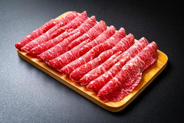 Fresh beef raw sliced served for sukiyaki and shabu or yakiniku