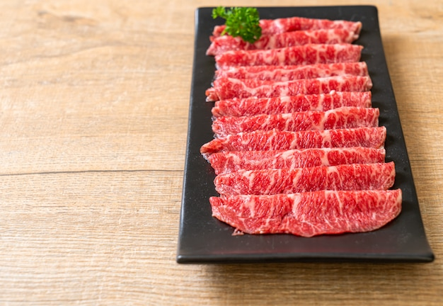 Fresh beef raw sliced with marbled texture