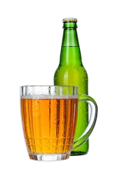 Fresh beer glass and bottle close up isolated on white