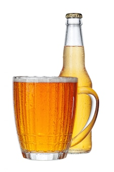 Fresh beer glass and bottle close up isolated