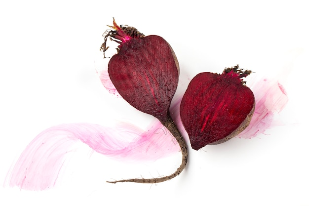Fresh beetroot halves on a white background