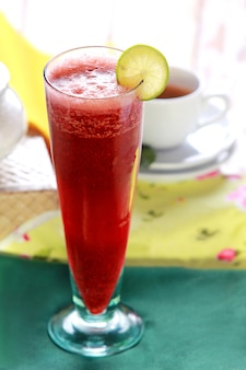 Fresh beetroot juice in a tall glass