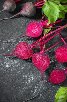 Fresh beets on a black  for frying
