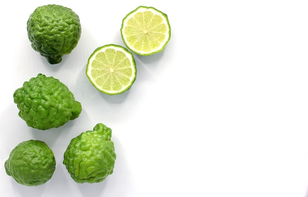 Fresh bergamot fruit isolated on white wall with copy space
