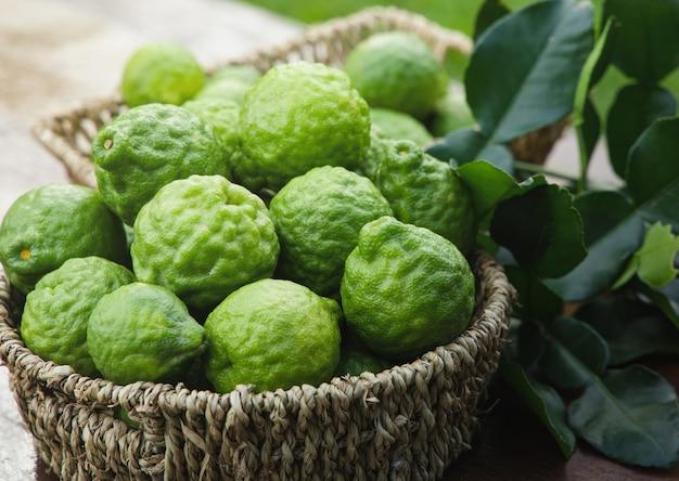 Fresh bergamot fruit on wooden table background