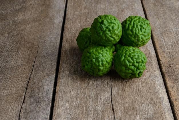 Fresh bergamot fruit on wooden table
