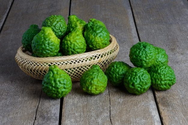 Fresh bergamot fruit on wooden table