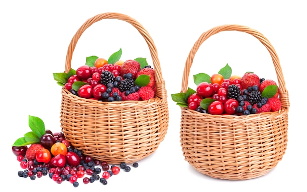 Fresh berries in basket on white
