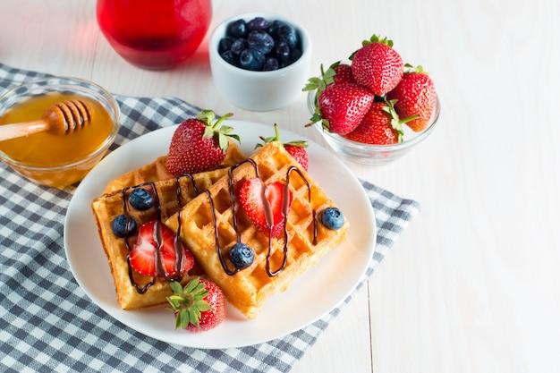 Fresh berry belgian waffles with honey