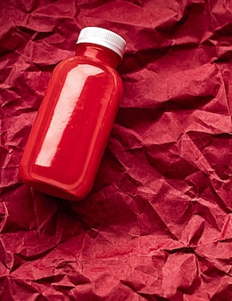 Fresh berry juice in ecofriendly recyclable plastic bottle and packaging healthy drink and food prod...