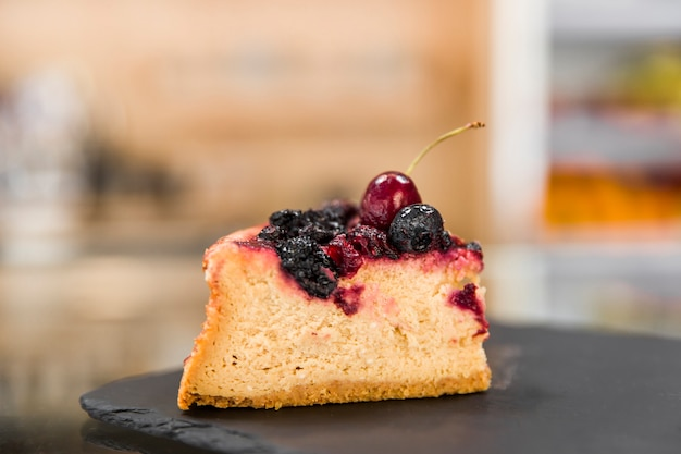 Fresh berry pastry on shale board