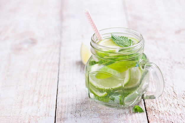 Fresh beverage with lemon and aromatic herbs