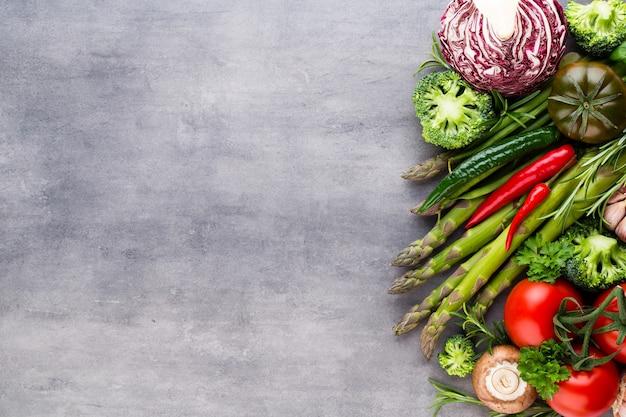 Fresh bio vegetables on gray stone.