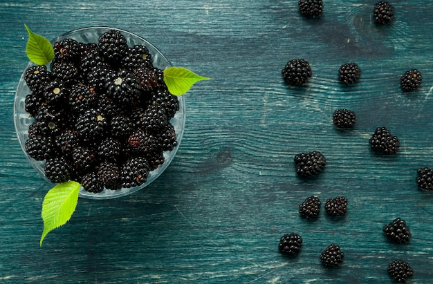 Fresh blackberry. juicy blackberry in a bowl on a wooden table harvest concept