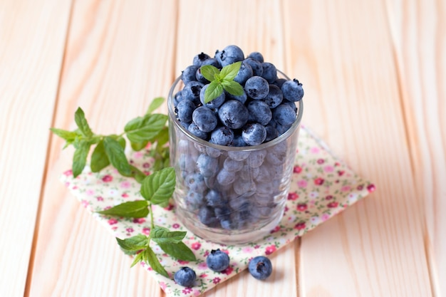 Fresh blueberries in a glass