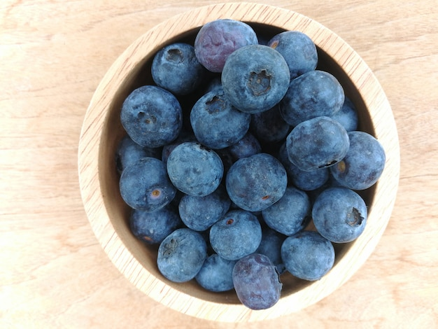 Fresh blueberries / ripe blueberries in wooden bowl - blueberry fruit for healthy